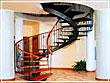 Винтовые лестницы: новый виток пространства для коттеджа